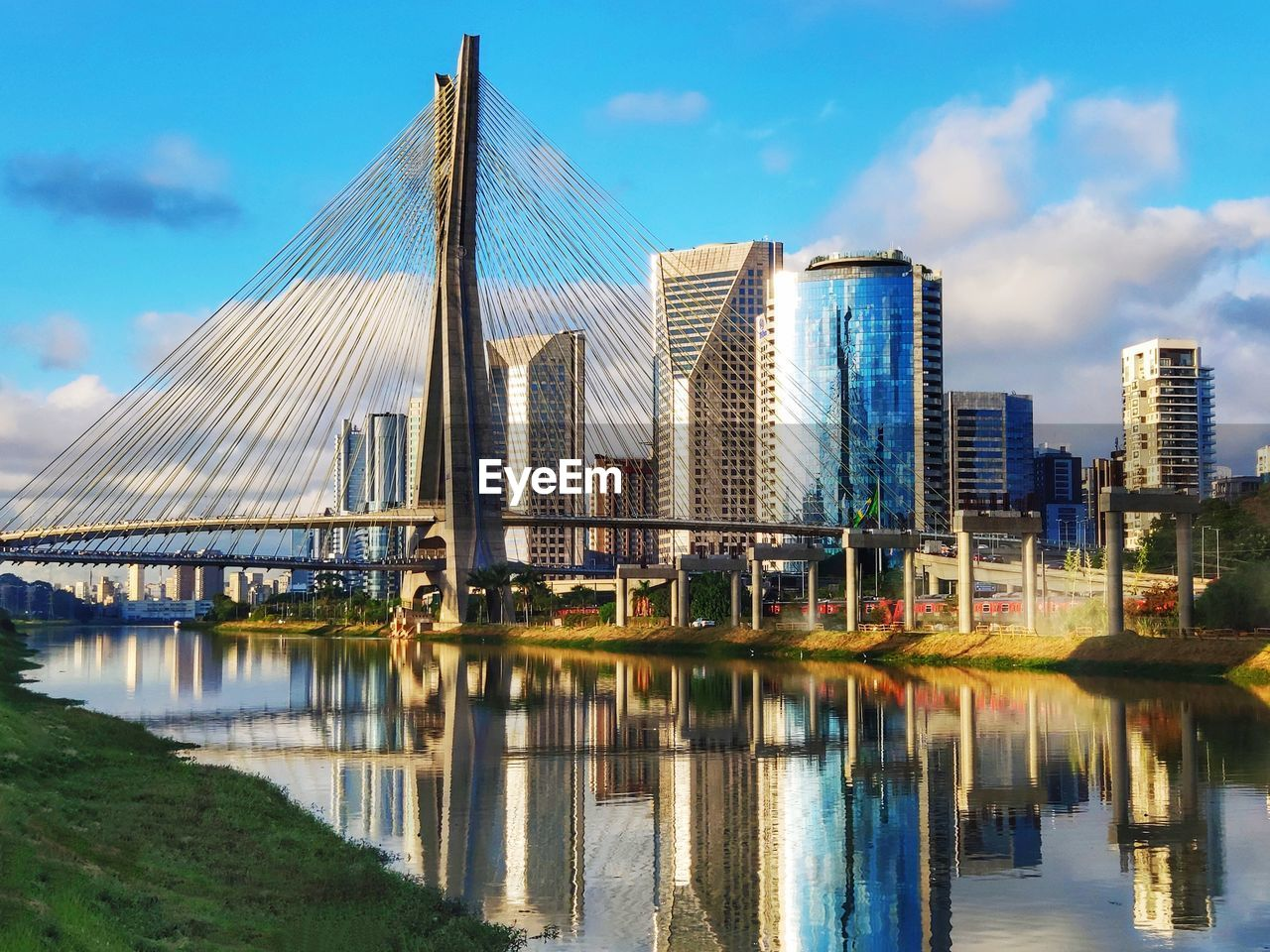 built structure, sky, architecture, water, cloud - sky, bridge, connection, bridge - man made structure, transportation, building exterior, nature, river, waterfront, no people, reflection, city, day, outdoors, office building exterior, skyscraper, modern, financial district