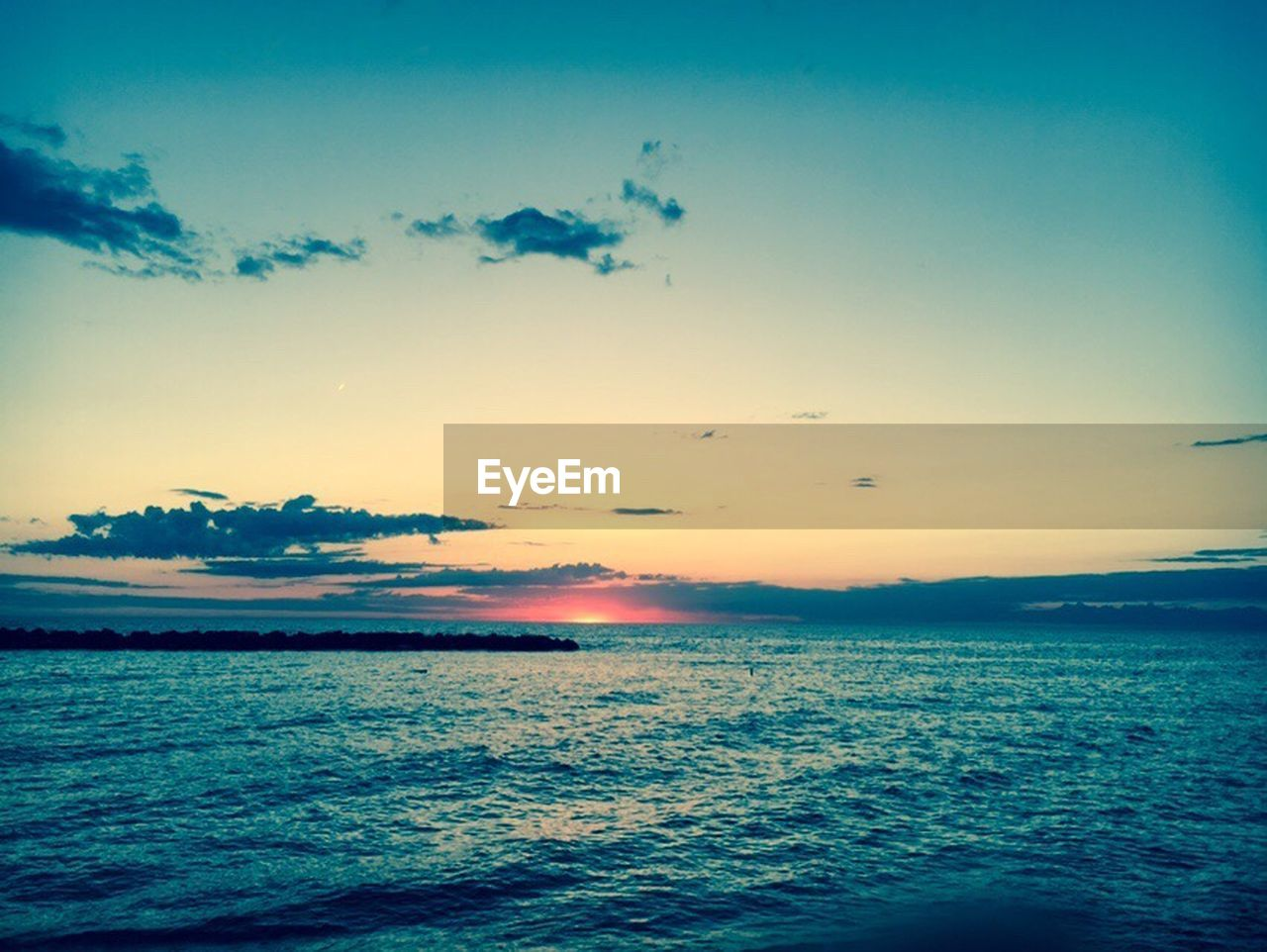 sea, sunset, water, scenics, tranquil scene, beauty in nature, nature, sky, tranquility, horizon over water, no people, rippled, outdoors, waterfront, beach, blue, wave, day