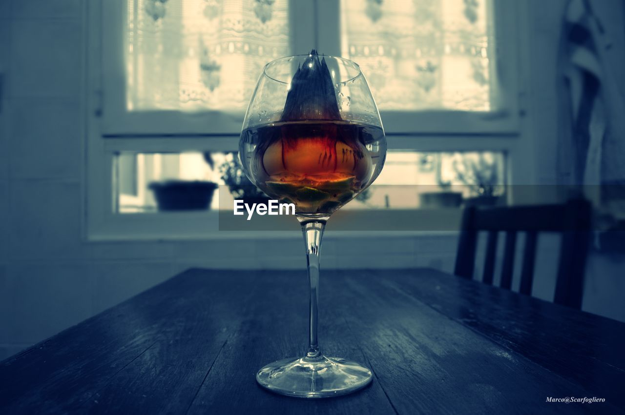 wineglass, table, wine, alcohol, drink, red wine, no people, refreshment, indoors, food and drink, drinking glass, close-up, wood - material, focus on foreground, day, freshness