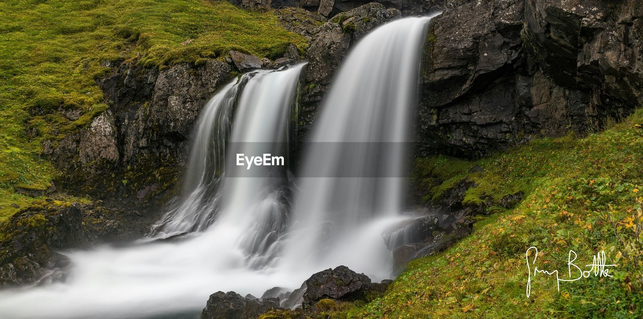 waterfall, motion, long exposure, blurred motion, flowing water, water, beauty in nature, rock - object, nature, scenics, rock formation, idyllic, non-urban scene, river, outdoors, environment, no people, cliff, travel destinations, rapid, power in nature, tranquil scene, tranquility, day, plant, forest, tree
