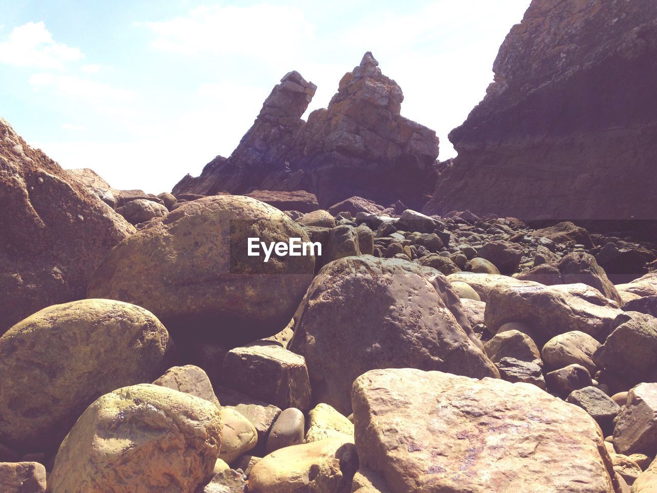 rock - object, nature, rock formation, rock, outdoors, day, geology, no people, beauty in nature, mountain, tranquility, sky, tranquil scene, pebble beach, physical geography, cliff, scenics, water