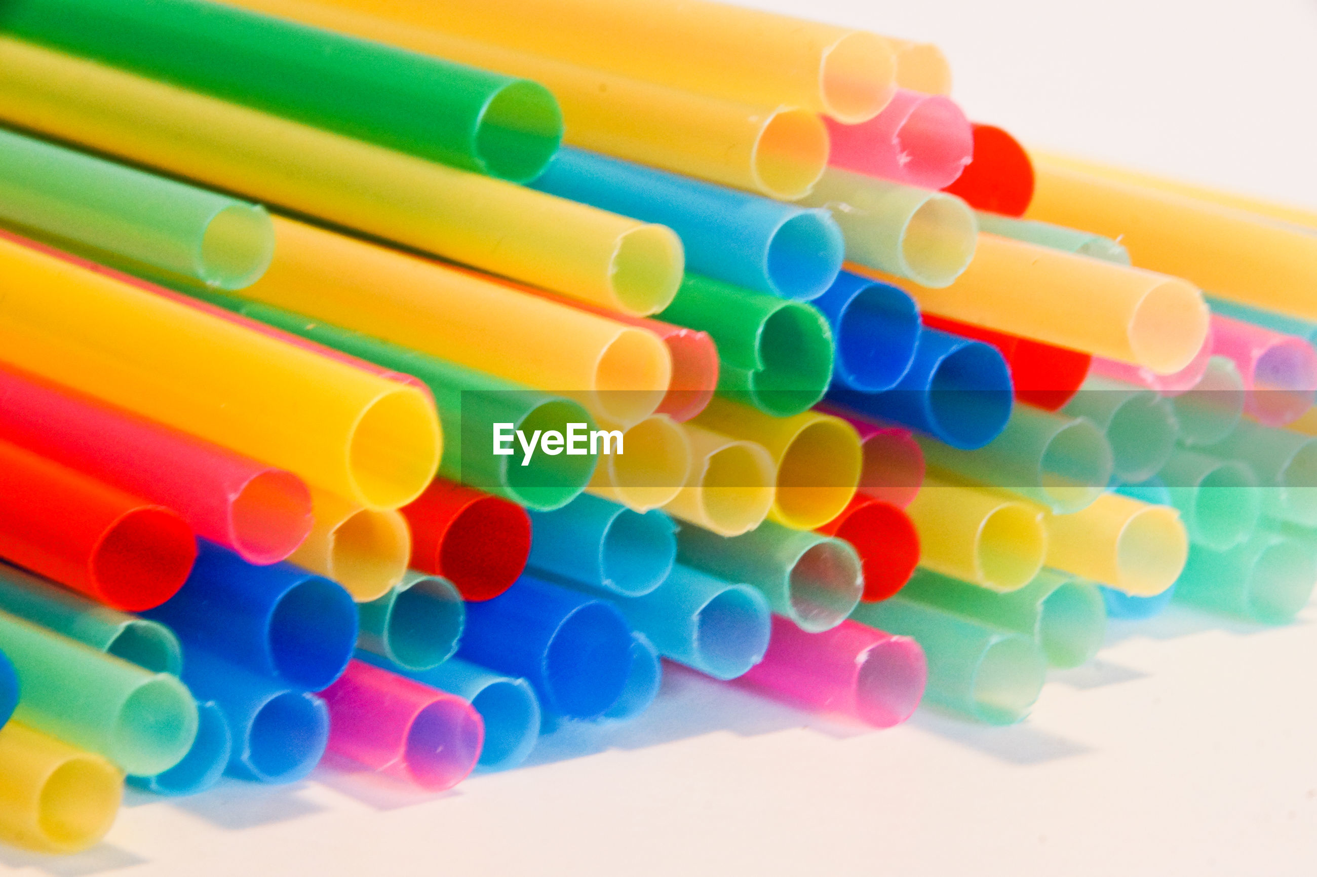 Close-up of colorful drinking straws on table