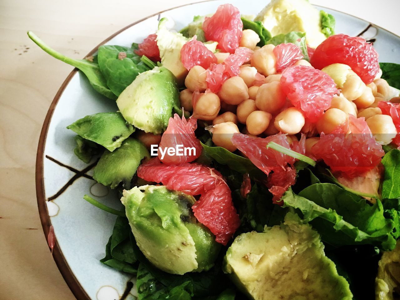 Close-up of salad with avocado and grapefruit on table