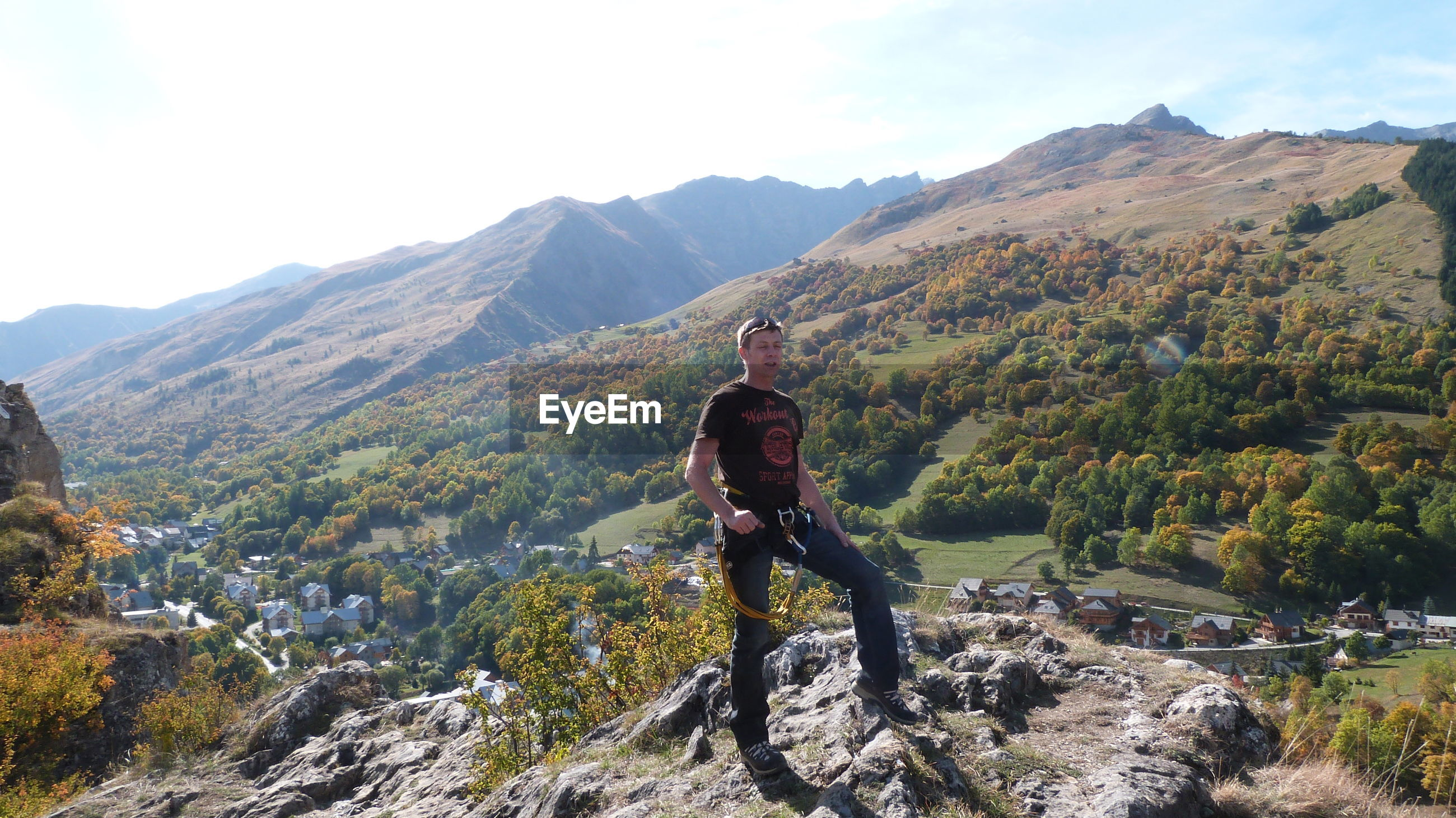 Full length of mature man standing on mountain against sky