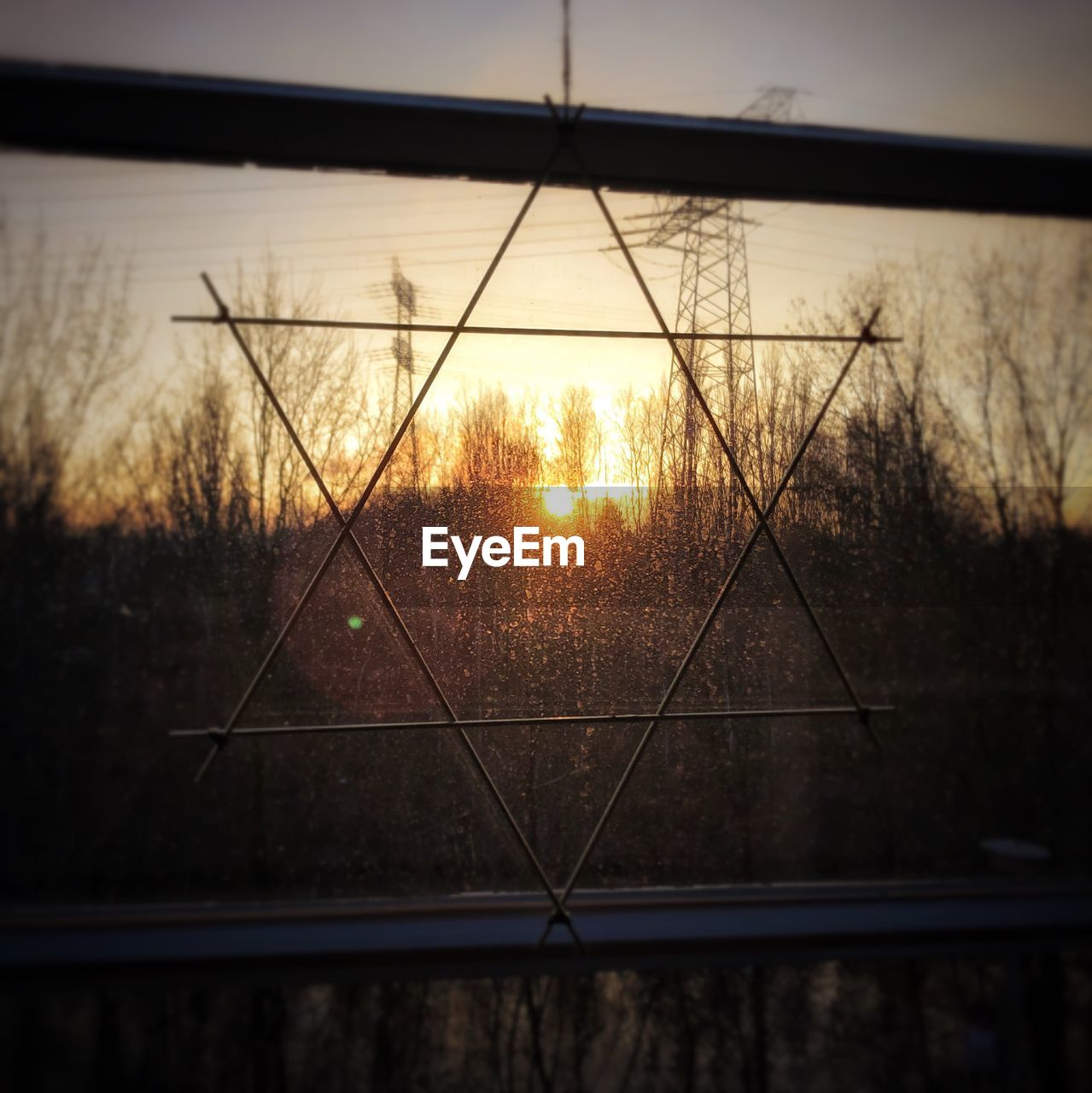 Sky seen through glass window during sunset