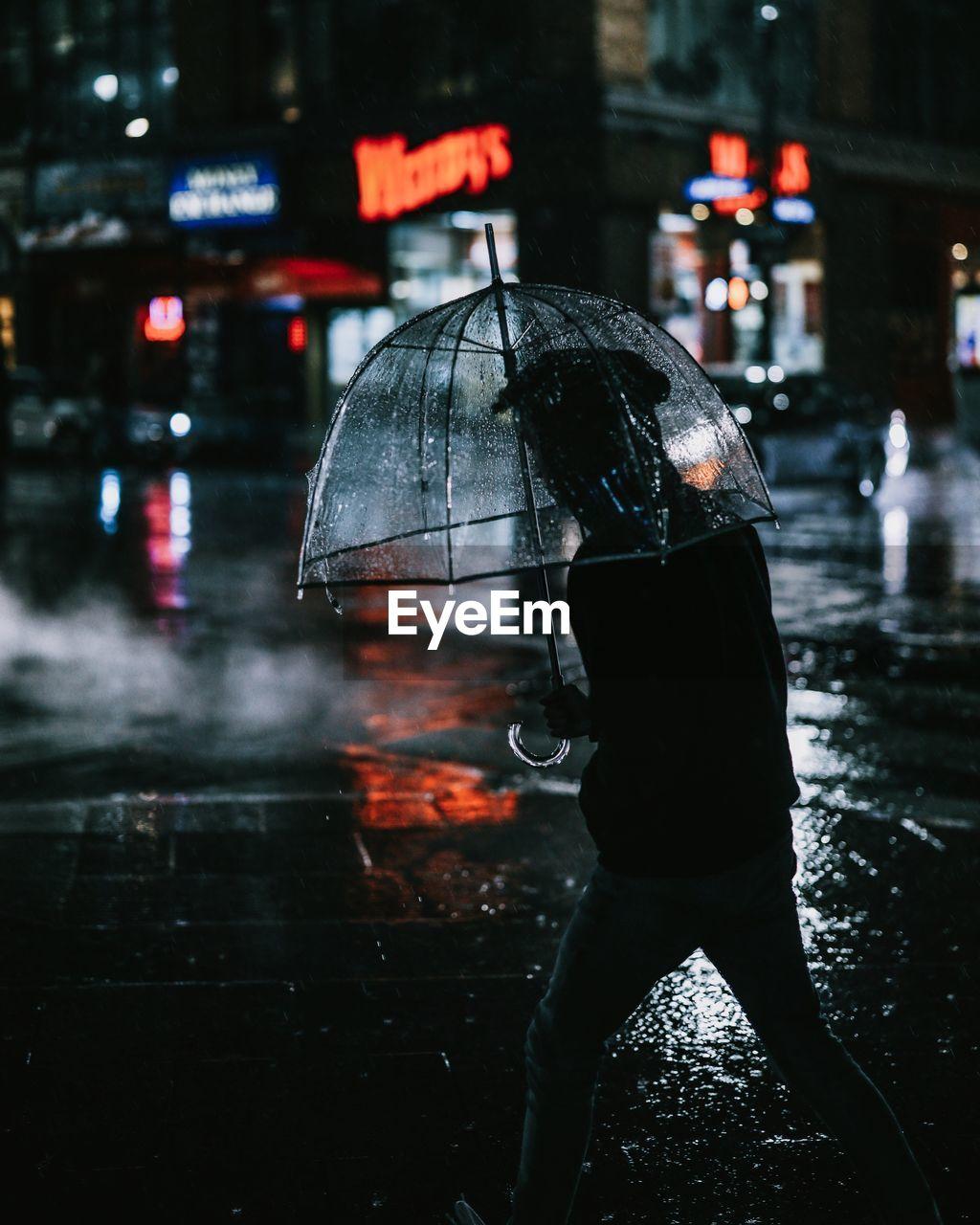 Reflection in city during rainy season at night