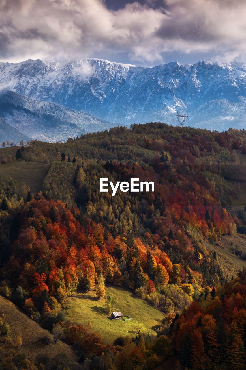 SCENIC VIEW OF SNOWCAPPED MOUNTAINS AGAINST SKY DURING AUTUMN