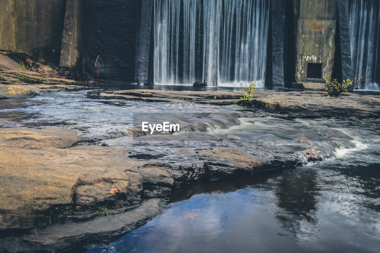 water, rock, waterfall, scenics - nature, nature, solid, no people, beauty in nature, rock - object, motion, forest, day, long exposure, waterfront, flowing, flowing water, tree, outdoors, river, power in nature