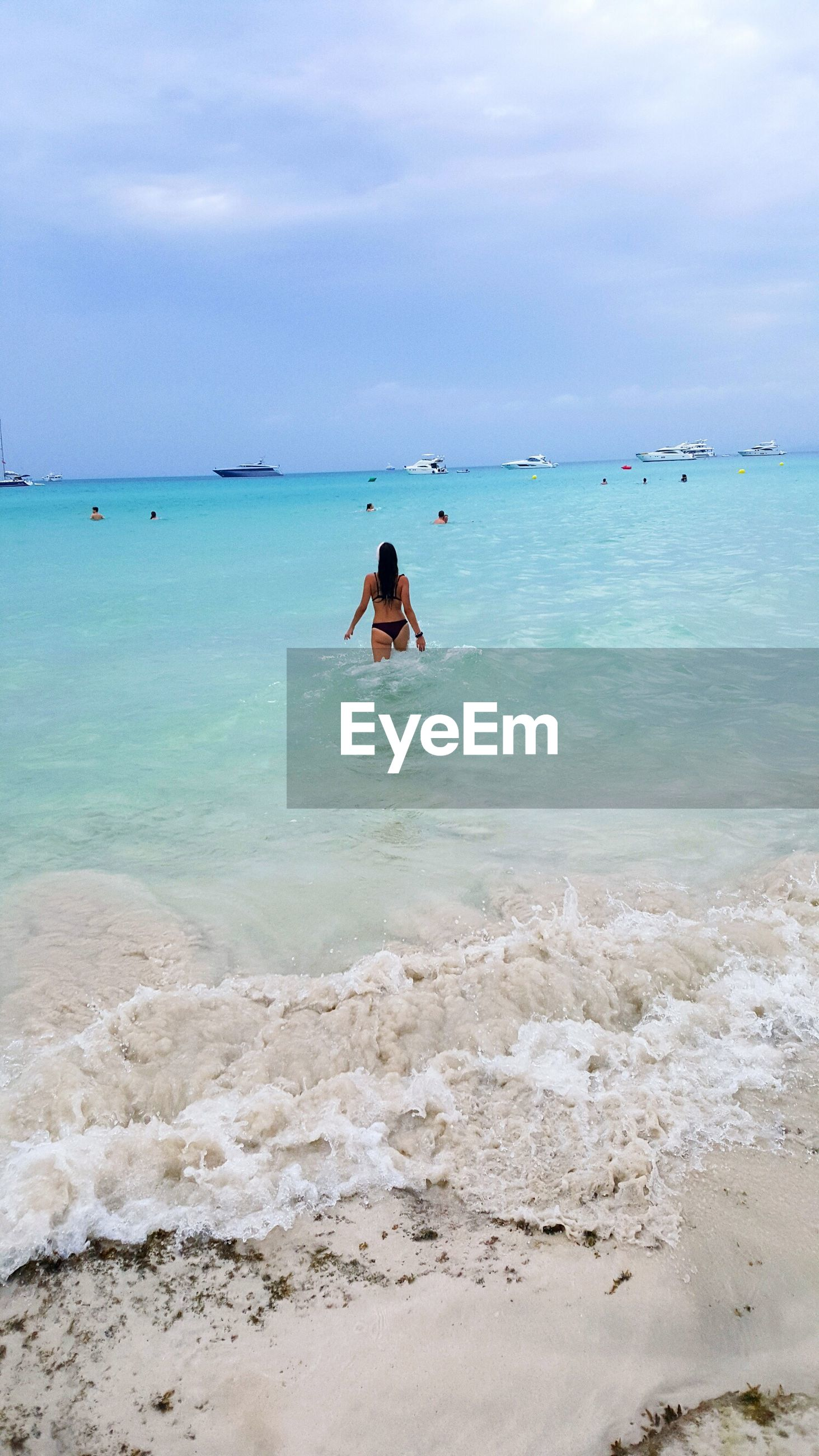 sea, horizon over water, sky, beauty in nature, water, scenics, beach, nature, cloud - sky, one person, real people, tranquility, day, leisure activity, outdoors, tranquil scene, sand, vacations, lifestyles, women, people