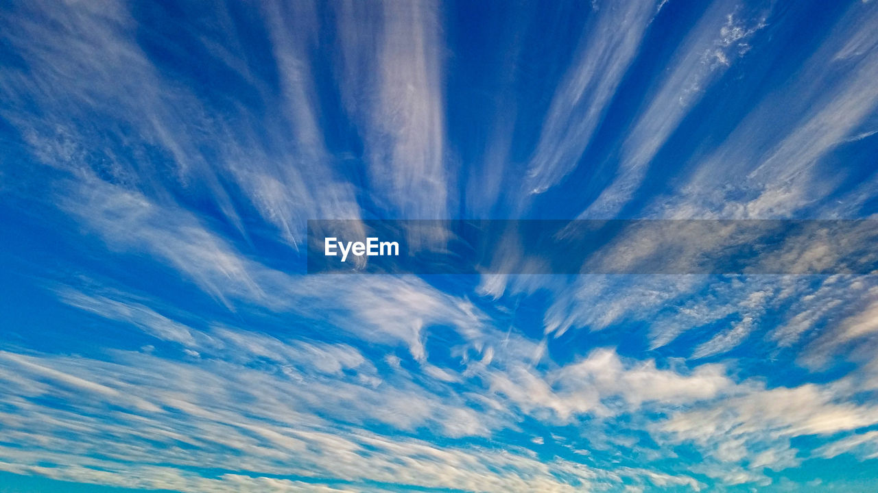 sky, cloud - sky, blue, nature, beauty in nature, backgrounds, low angle view, no people, scenics - nature, cloudscape, tranquility, day, meteorology, outdoors, tranquil scene, environment, sunlight, climate, bright, wispy