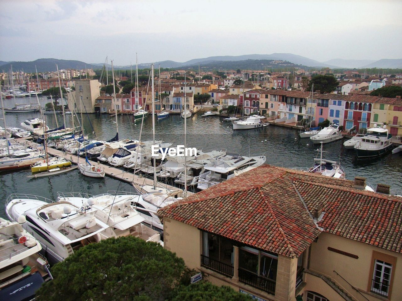 building exterior, built structure, architecture, transportation, nautical vessel, water, mode of transportation, city, building, sky, harbor, nature, residential district, day, moored, no people, roof, high angle view, sea, sailboat, outdoors, townscape, yacht, marina, port, bay