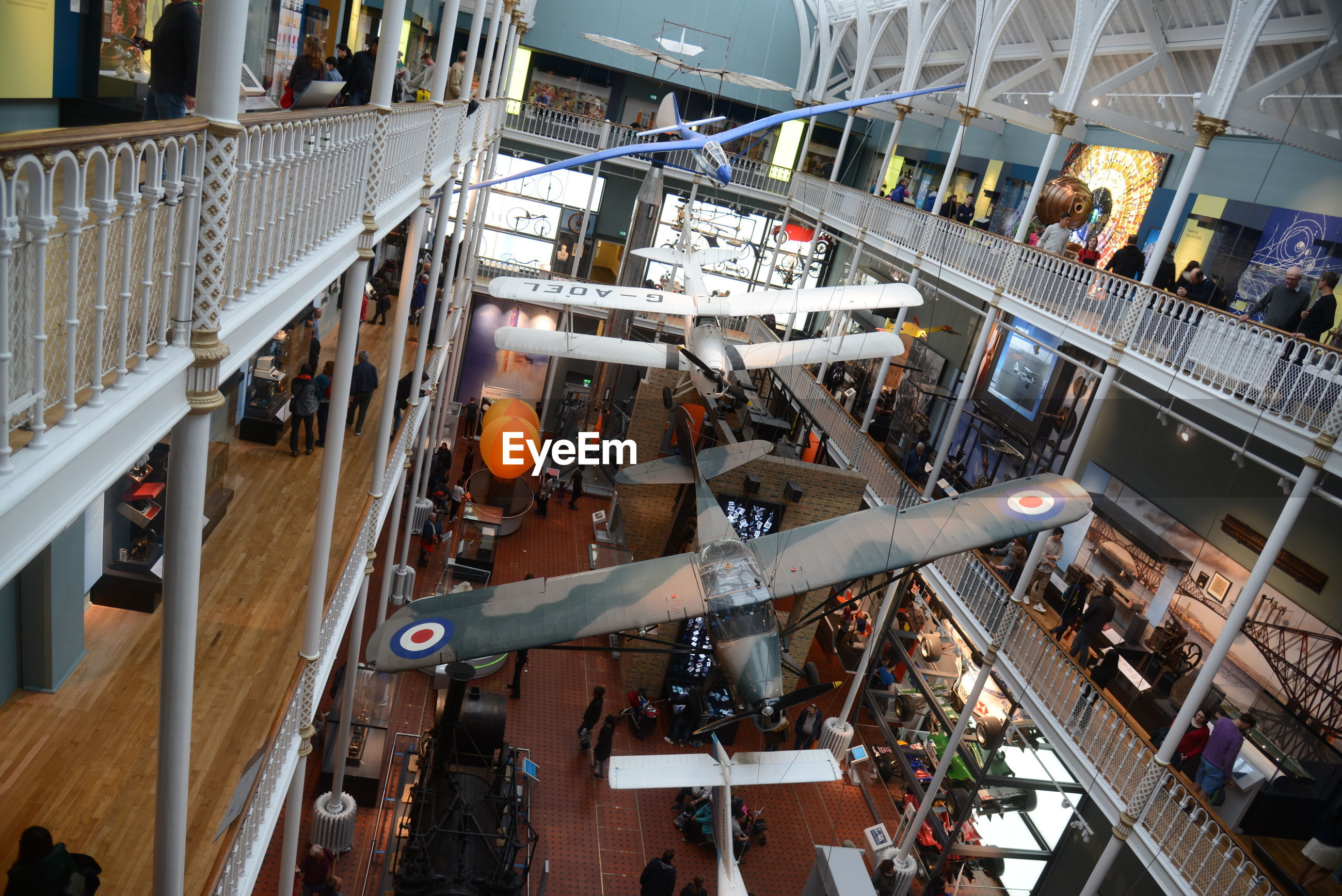 HIGH ANGLE VIEW OF PEOPLE ON SHOPPING MALL