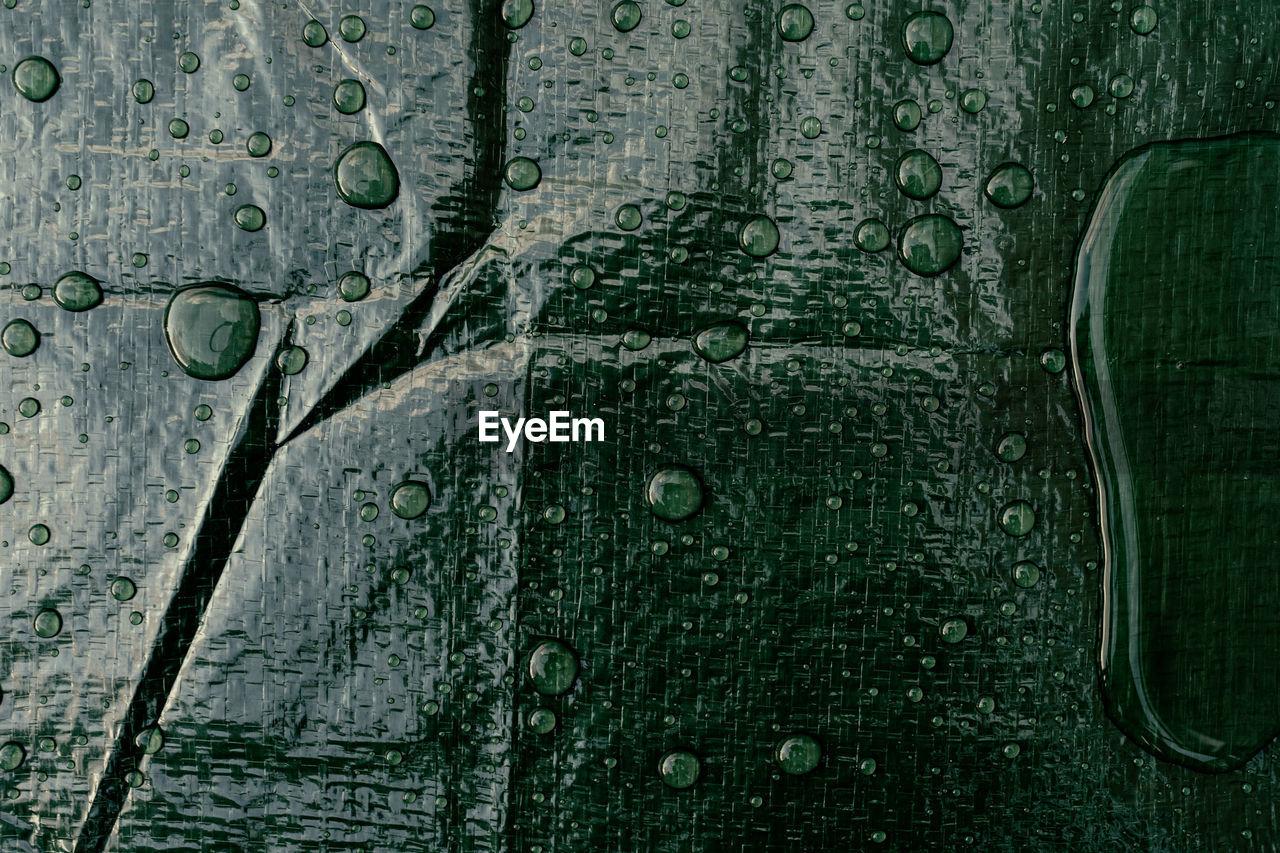 Full frame shot of wet tarpaulin