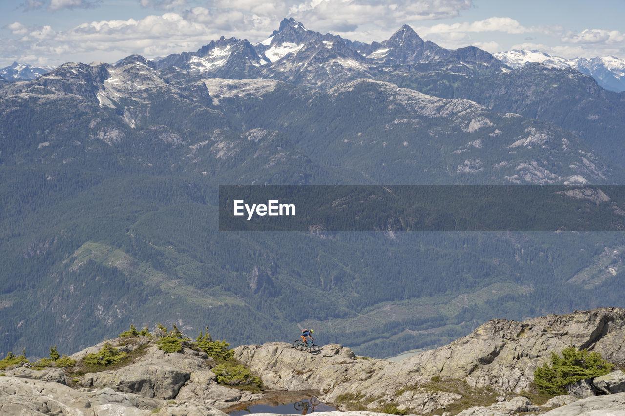 Man riding bicycle on rocks