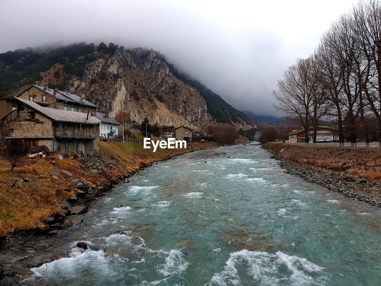 water, built structure, architecture, sky, nature, river, tree, no people, scenics - nature, mountain, beauty in nature, day, flowing water, motion, plant, hydroelectric power, flowing, dam, outdoors, stream - flowing water