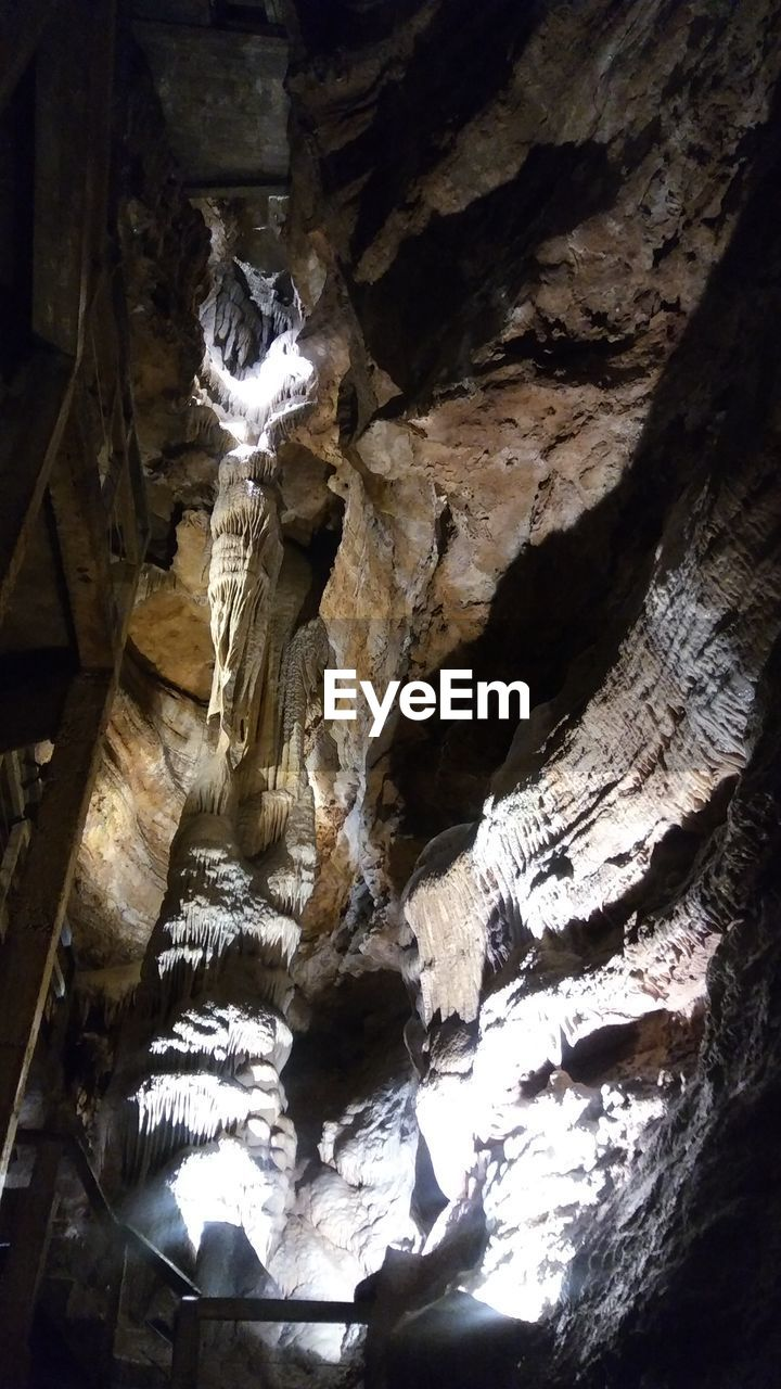 rock formation, geology, cave, physical geography, rock - object, stalactite, low angle view, textured, nature, no people, rough, indoors, beauty in nature, tranquility, travel destinations, day, sunlight, close-up