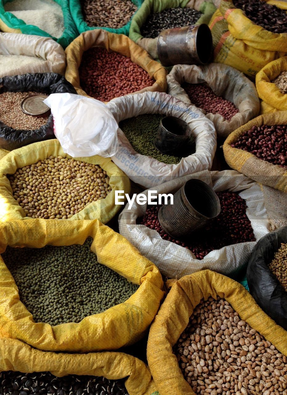 food and drink, food, sack, freshness, market, choice, large group of objects, variation, abundance, spice, market stall, ingredient, healthy eating, high angle view, retail, wellbeing, for sale, indoors, still life, no people