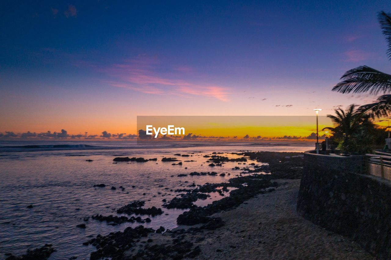 sunset, sky, scenics - nature, water, nature, beauty in nature, sea, tree, palm tree, tropical climate, no people, land, architecture, beach, cloud - sky, tranquil scene, orange color, plant, tranquility, outdoors, swimming pool