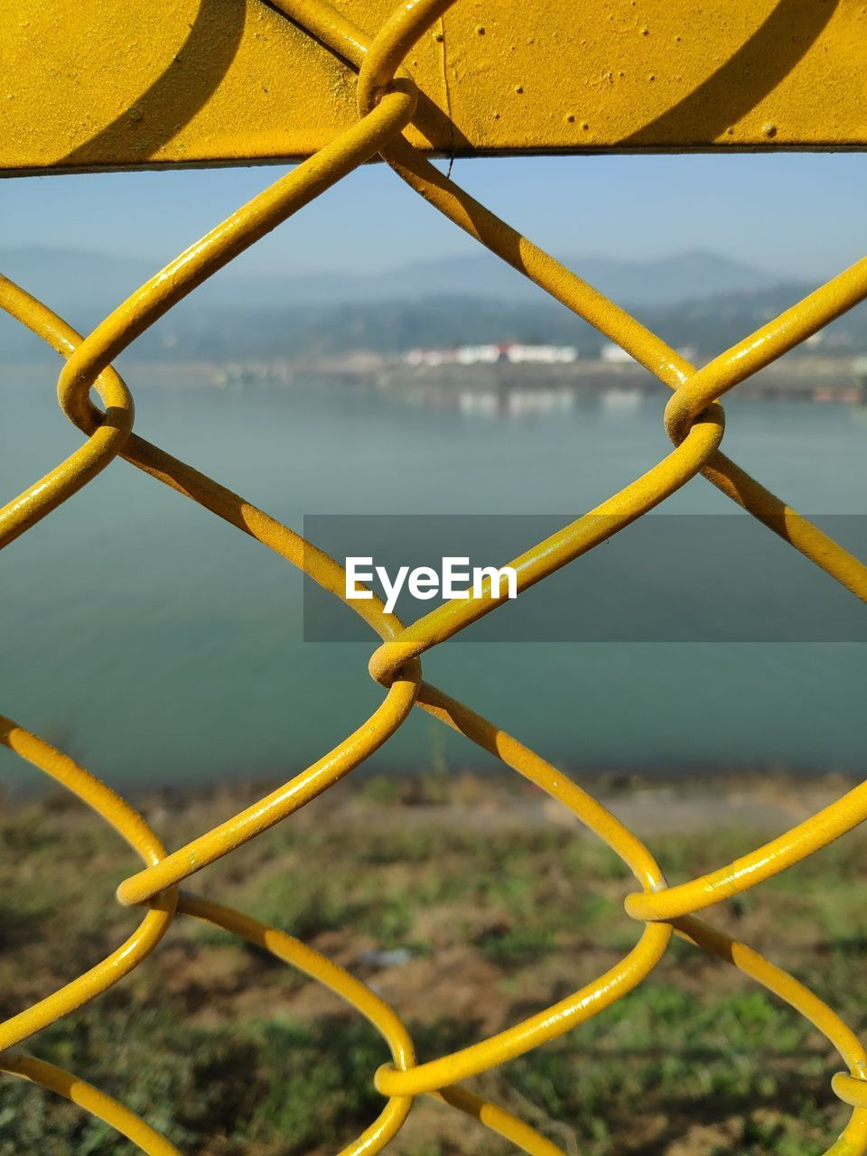 River seen through chainlink fence