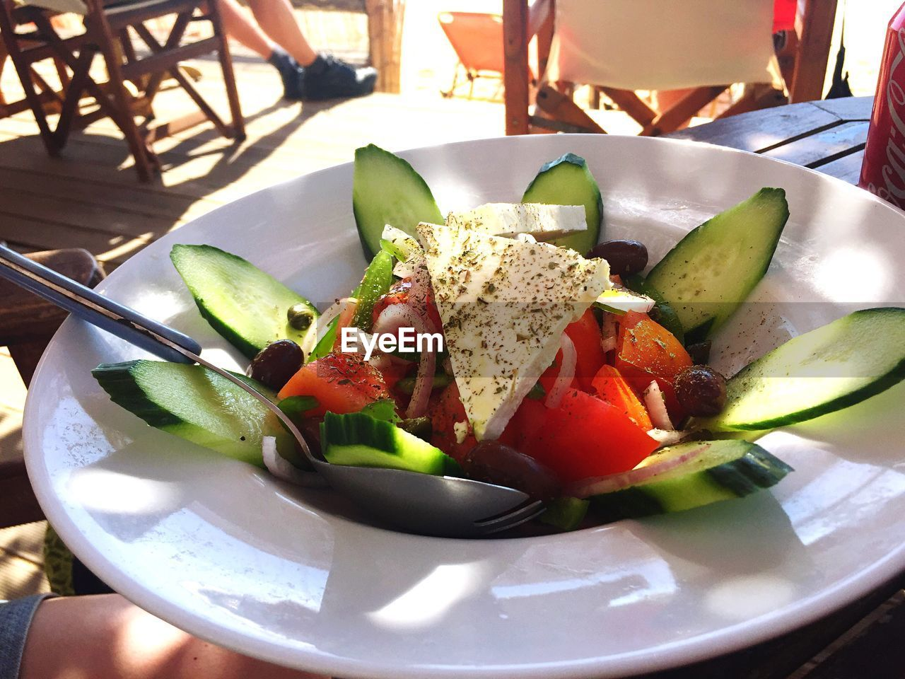 Close-up of fresh healthy salad served in restaurant