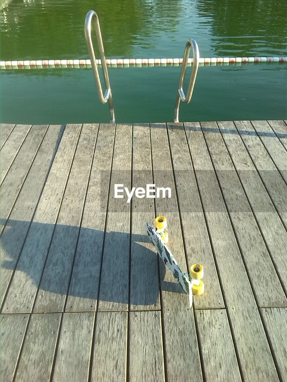 High Angle View Of Skateboard On Jetty