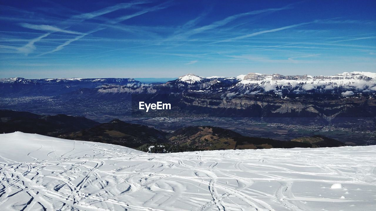 winter, cold temperature, snow, mountain, scenics - nature, beauty in nature, environment, landscape, tranquil scene, mountain range, tranquility, sky, non-urban scene, white color, snowcapped mountain, nature, day, no people, covering, ski resort