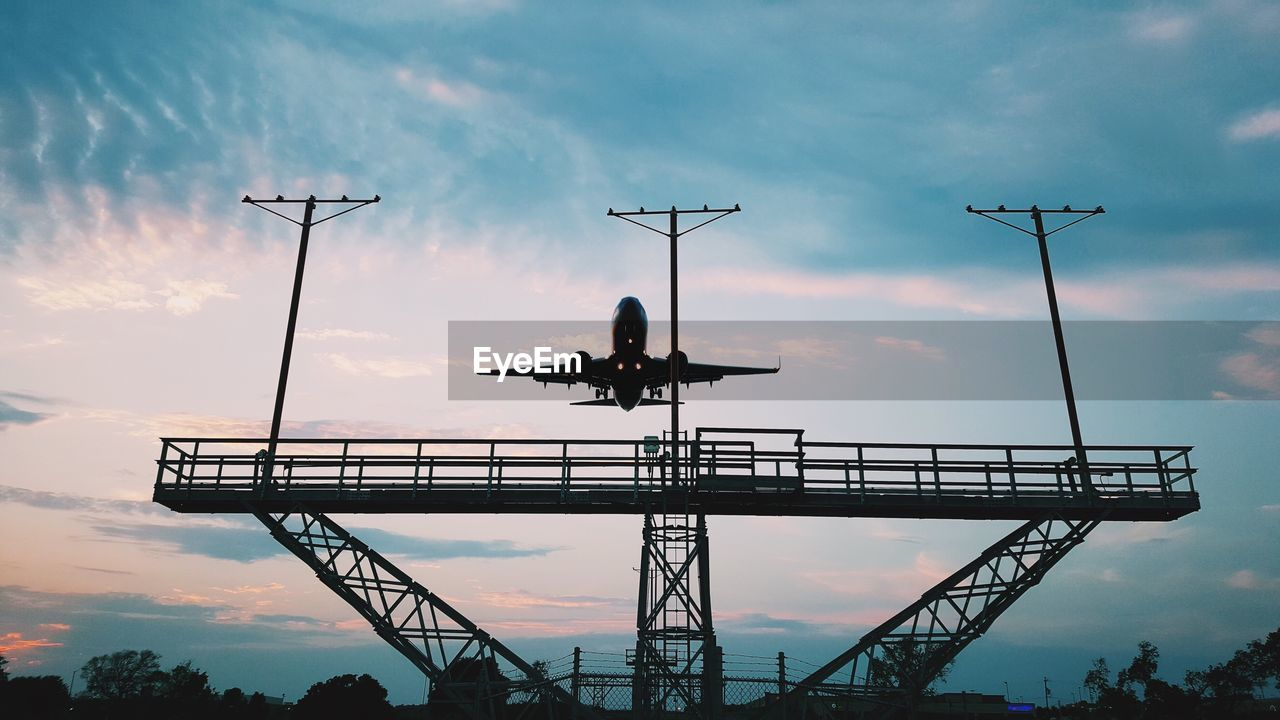 Low Angle View Of Airplane Against Sky