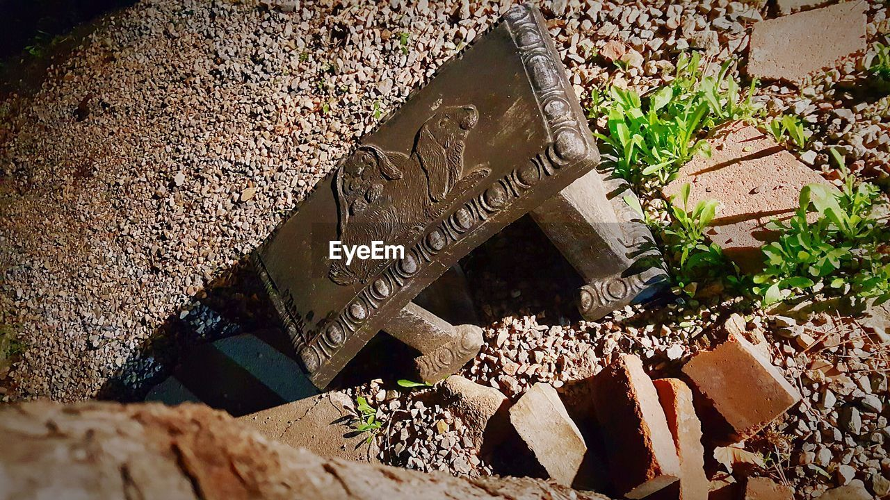 high angle view, text, no people, day, communication, sunlight, outdoors, grave, close-up, shadow
