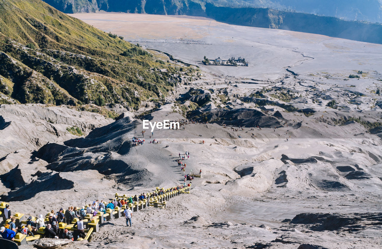 group of people, mountain, real people, crowd, large group of people, leisure activity, day, lifestyles, high angle view, nature, men, beauty in nature, holiday, landscape, sport, scenics - nature, vacations, travel, trip, environment, mountain range, outdoors