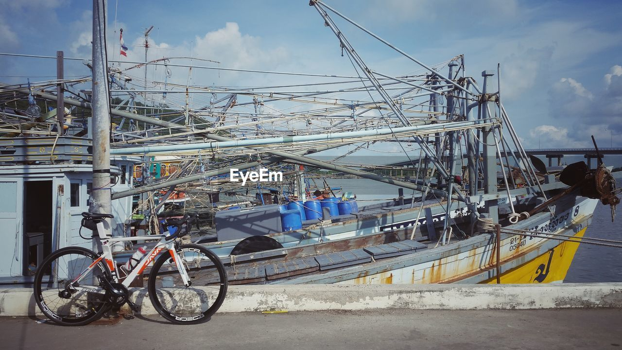 transportation, mode of transport, sky, nautical vessel, real people, outdoors, day, cloud - sky, bicycle, men, moored, water, large group of people, nature, sea, architecture, people