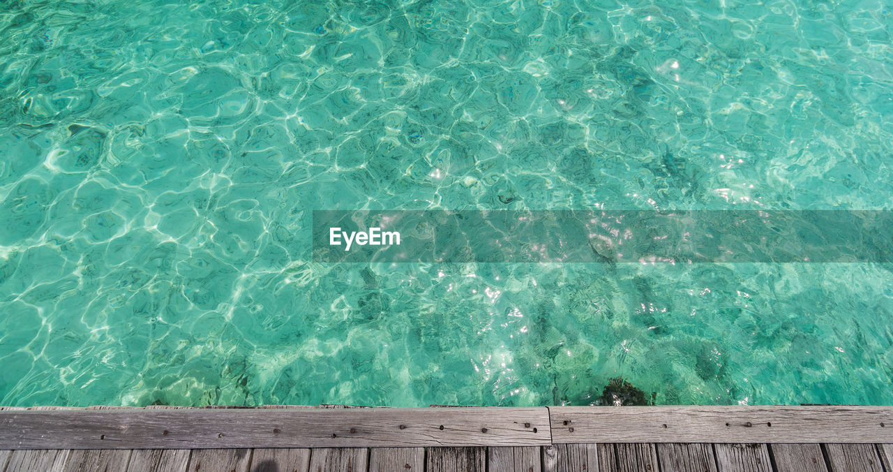 water, swimming pool, pool, sea, nature, turquoise colored, day, wood - material, high angle view, motion, no people, beauty in nature, outdoors, pier, blue, wave, green color, rippled, directly above