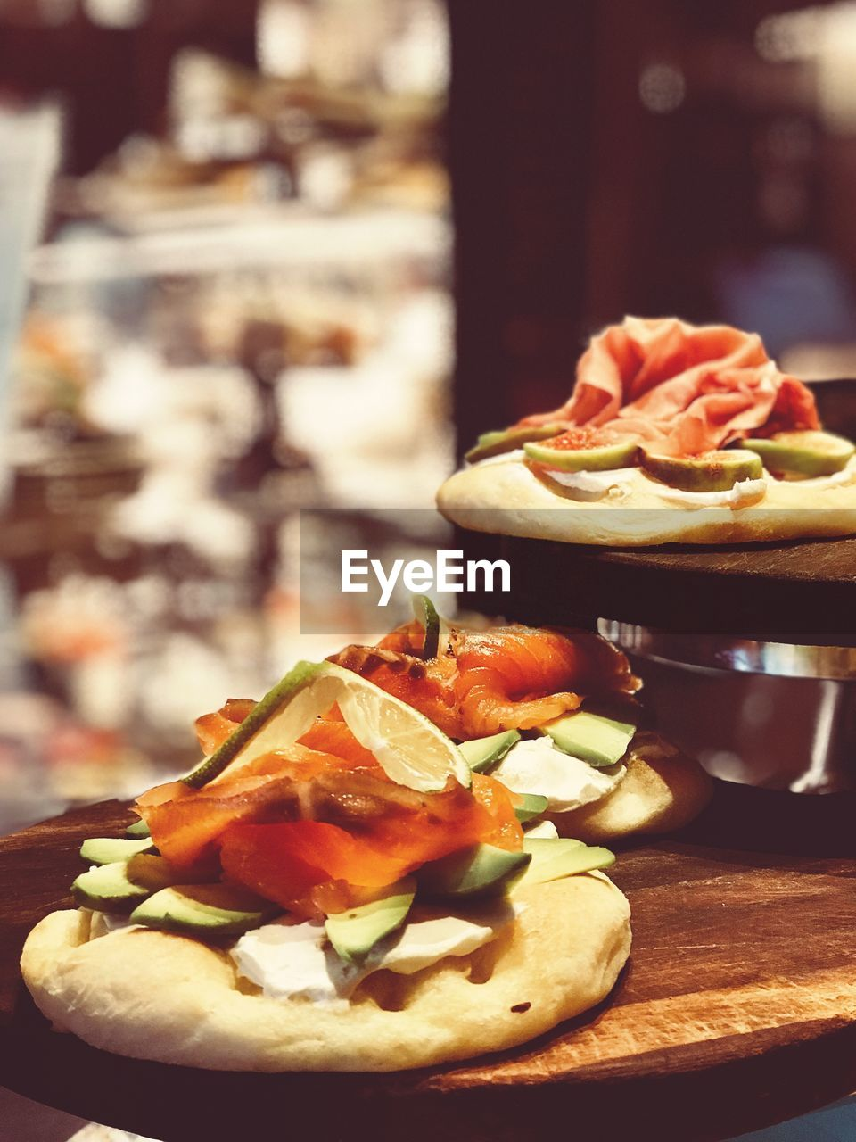 food and drink, food, freshness, table, ready-to-eat, focus on foreground, close-up, no people, indoors, fast food, sandwich, vegetable, plate, still life, healthy eating, bread, serving size, snack, restaurant