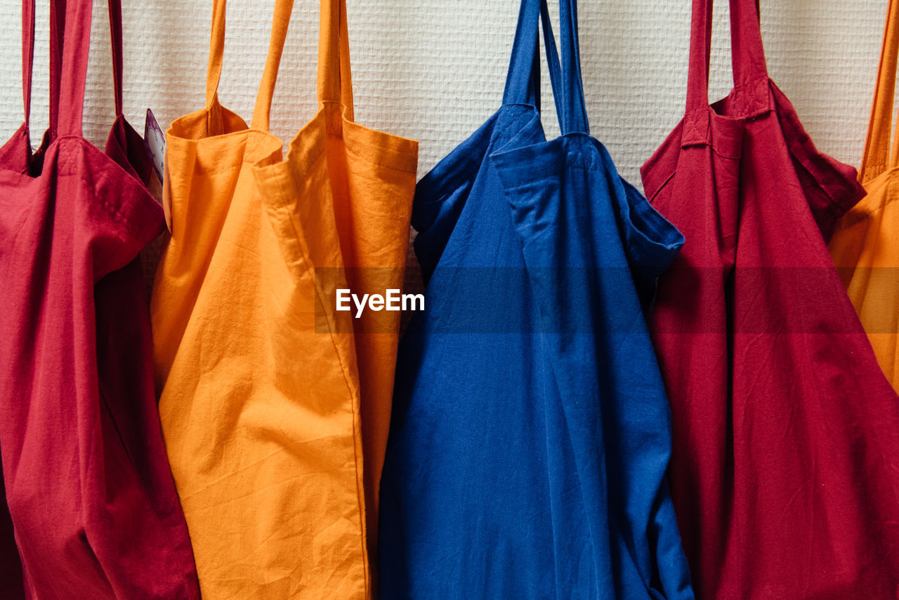 Close-up of bags hanging for sale