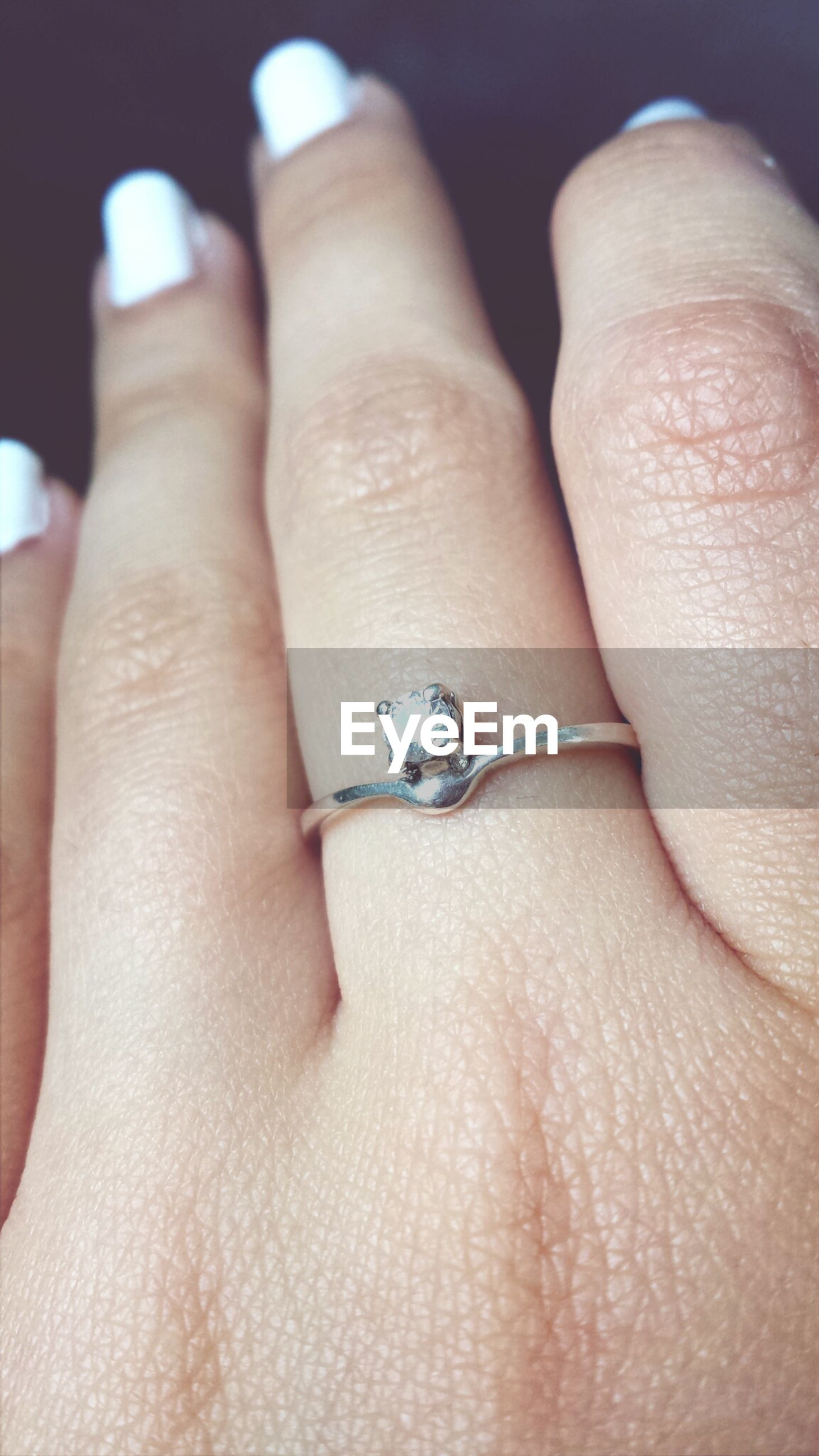 person, part of, lifestyles, close-up, human finger, leisure activity, personal perspective, nail polish, human skin, indoors, cropped, holding, ring, unrecognizable person, human foot