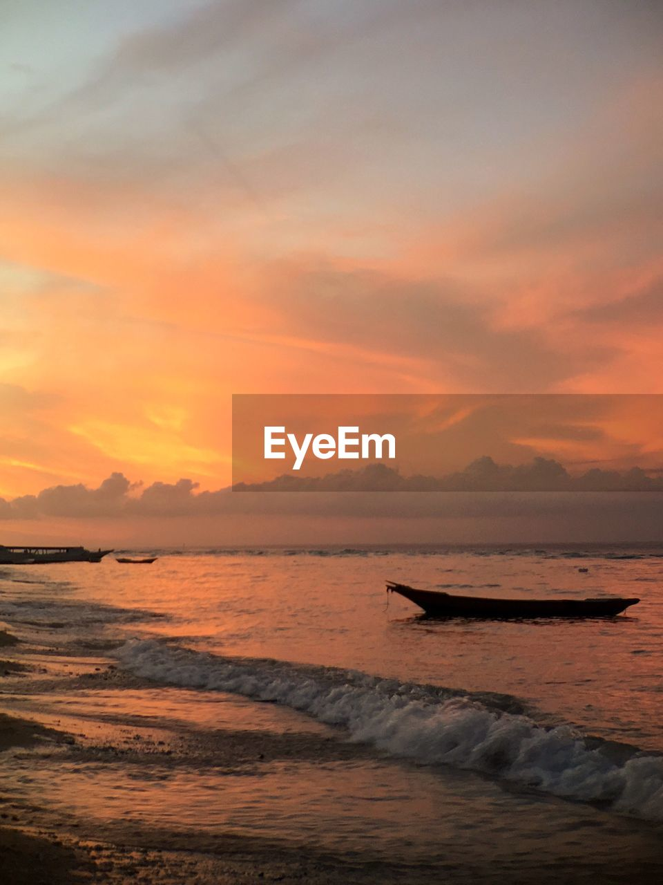 sunset, beauty in nature, scenics, sea, water, orange color, nature, tranquility, sky, tranquil scene, no people, cloud - sky, nautical vessel, outdoors, beach, horizon over water, wave