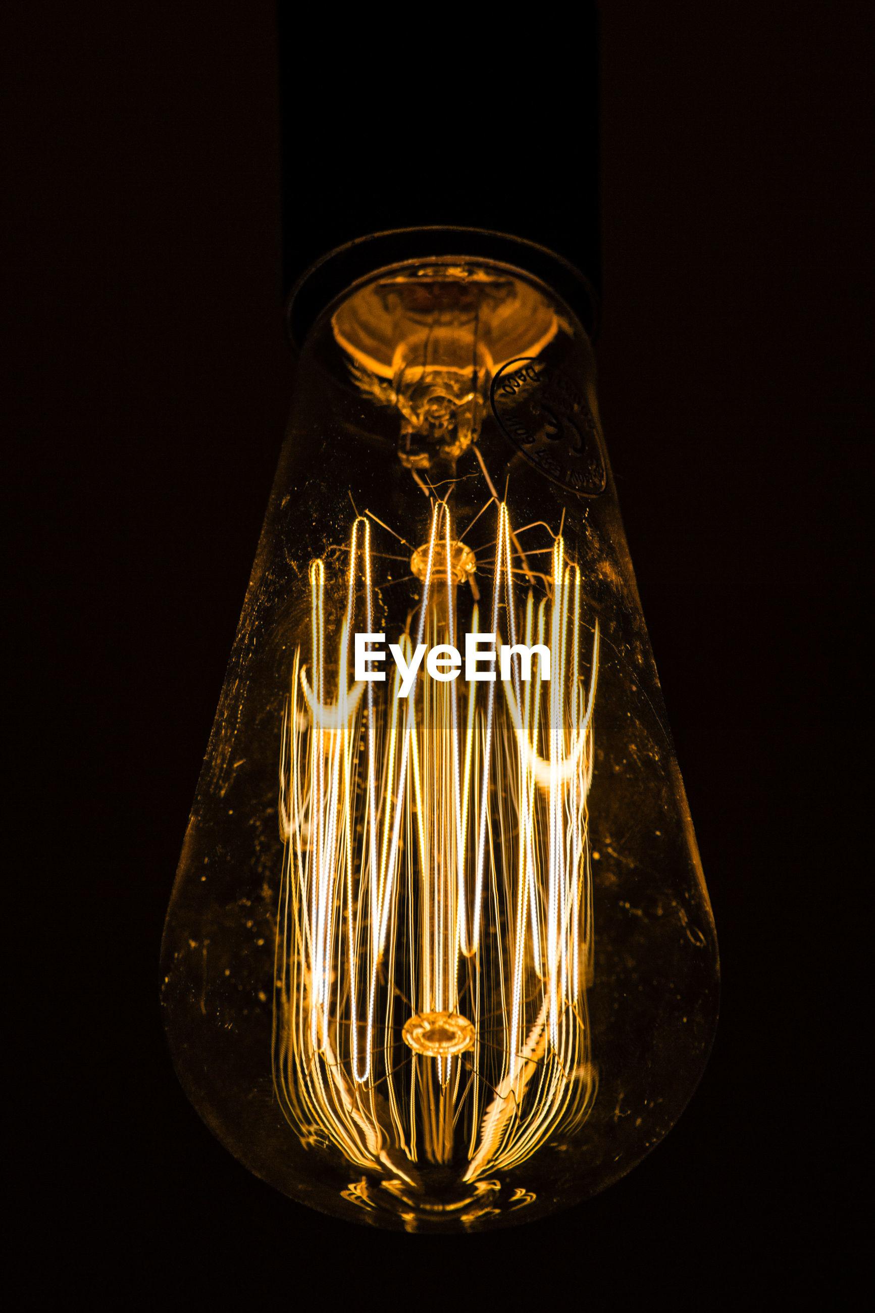 Illuminated light bulb in darkroom
