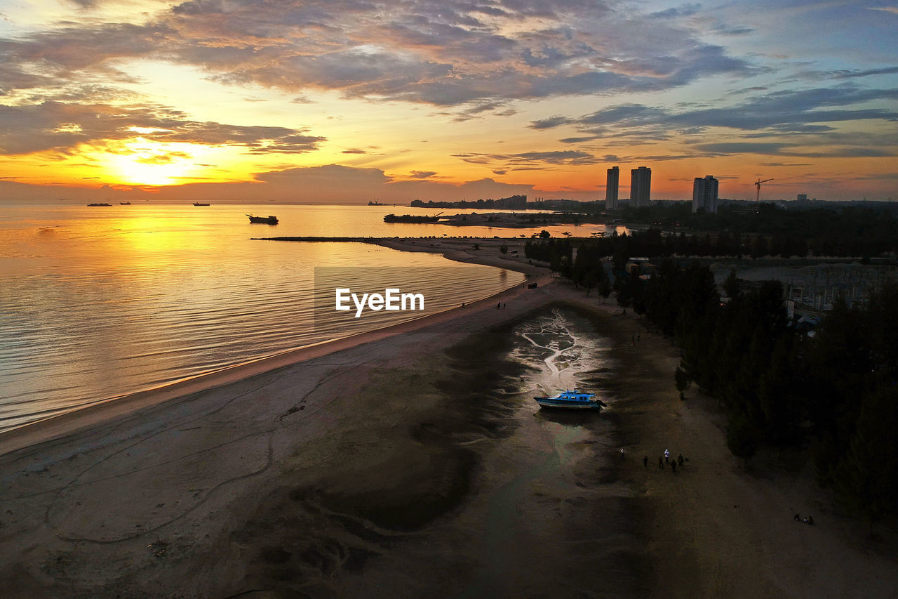sunset, sky, cloud - sky, built structure, architecture, building exterior, water, orange color, nature, city, scenics - nature, beauty in nature, sea, transportation, mode of transportation, no people, outdoors, land, high angle view, office building exterior, skyscraper
