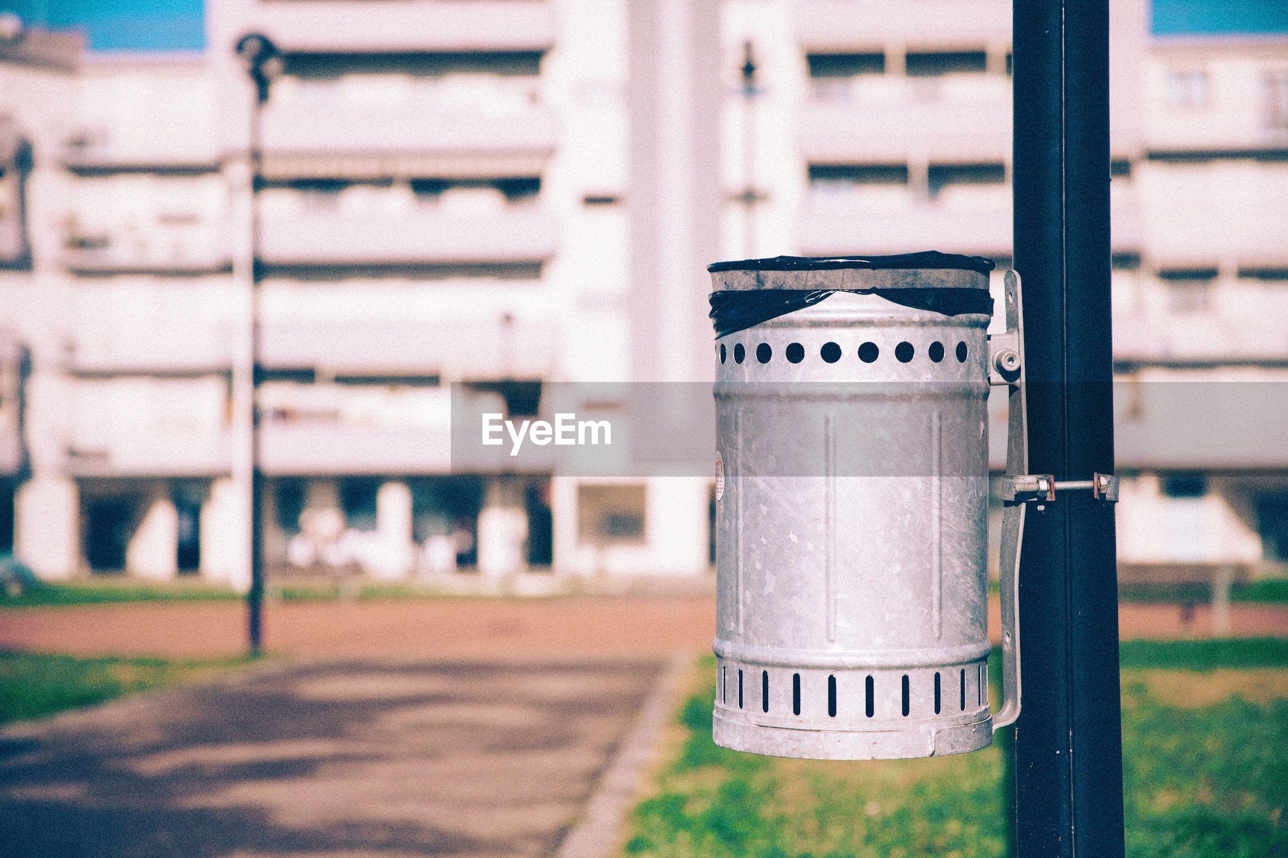 Close-up of metal bin in park