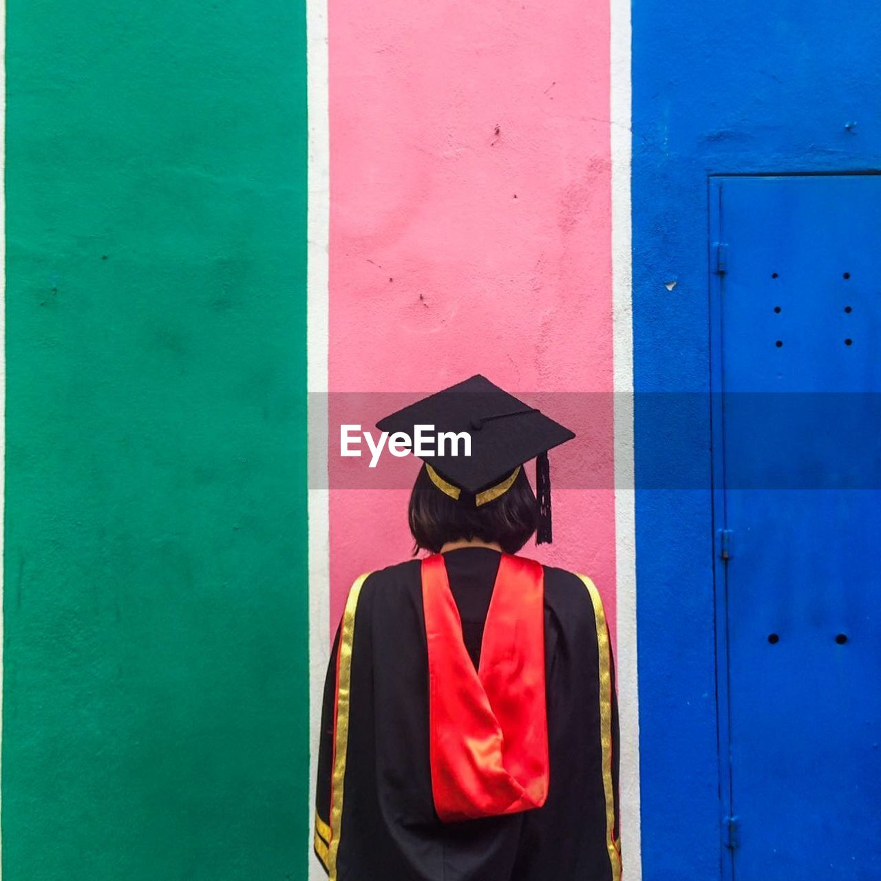 Rear View Of Person Wearing Graduation Gown
