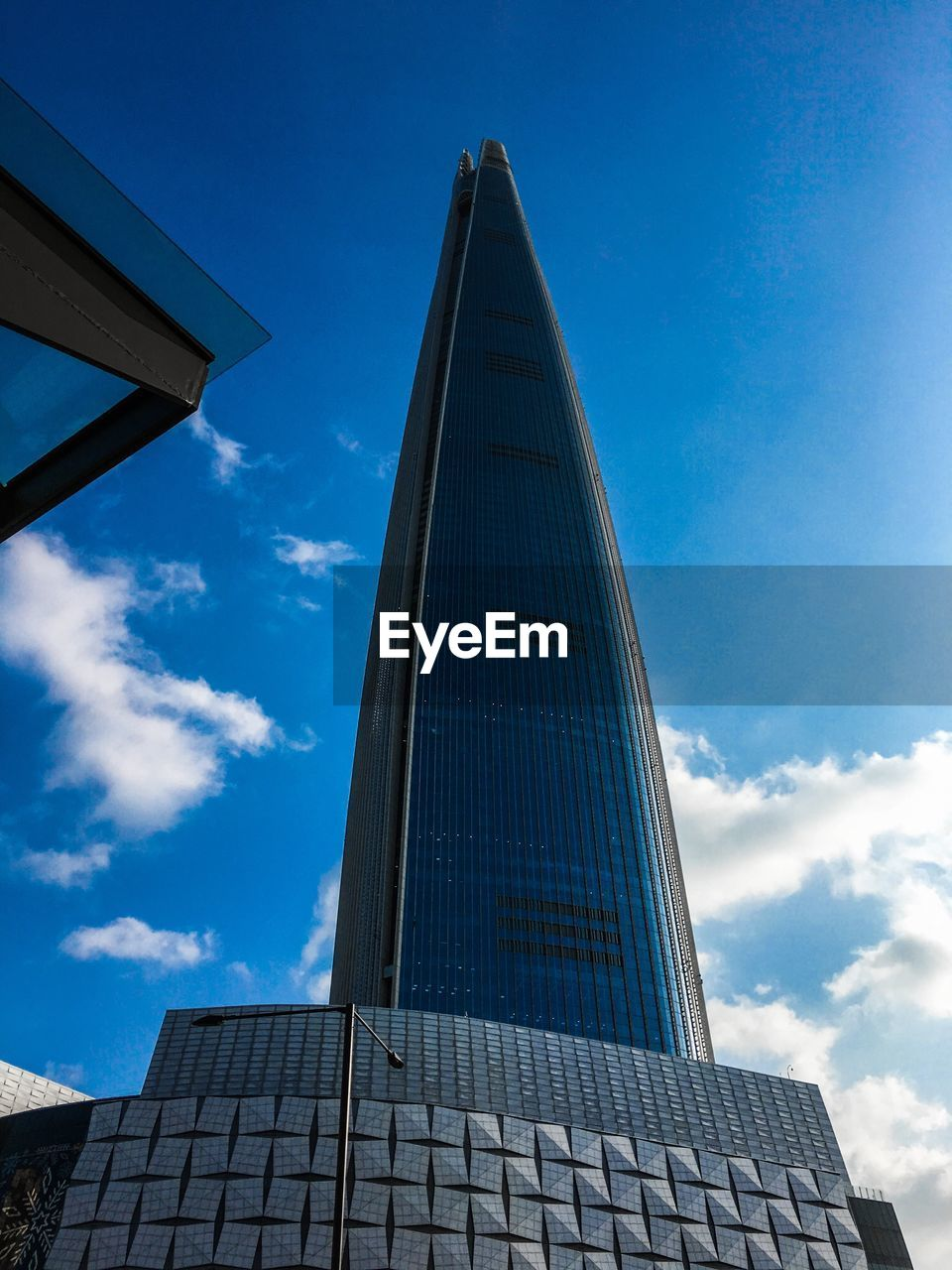 architecture, built structure, sky, low angle view, building exterior, building, cloud - sky, nature, no people, day, modern, tower, city, tall - high, blue, outdoors, office, office building exterior, sunlight, glass - material, skyscraper