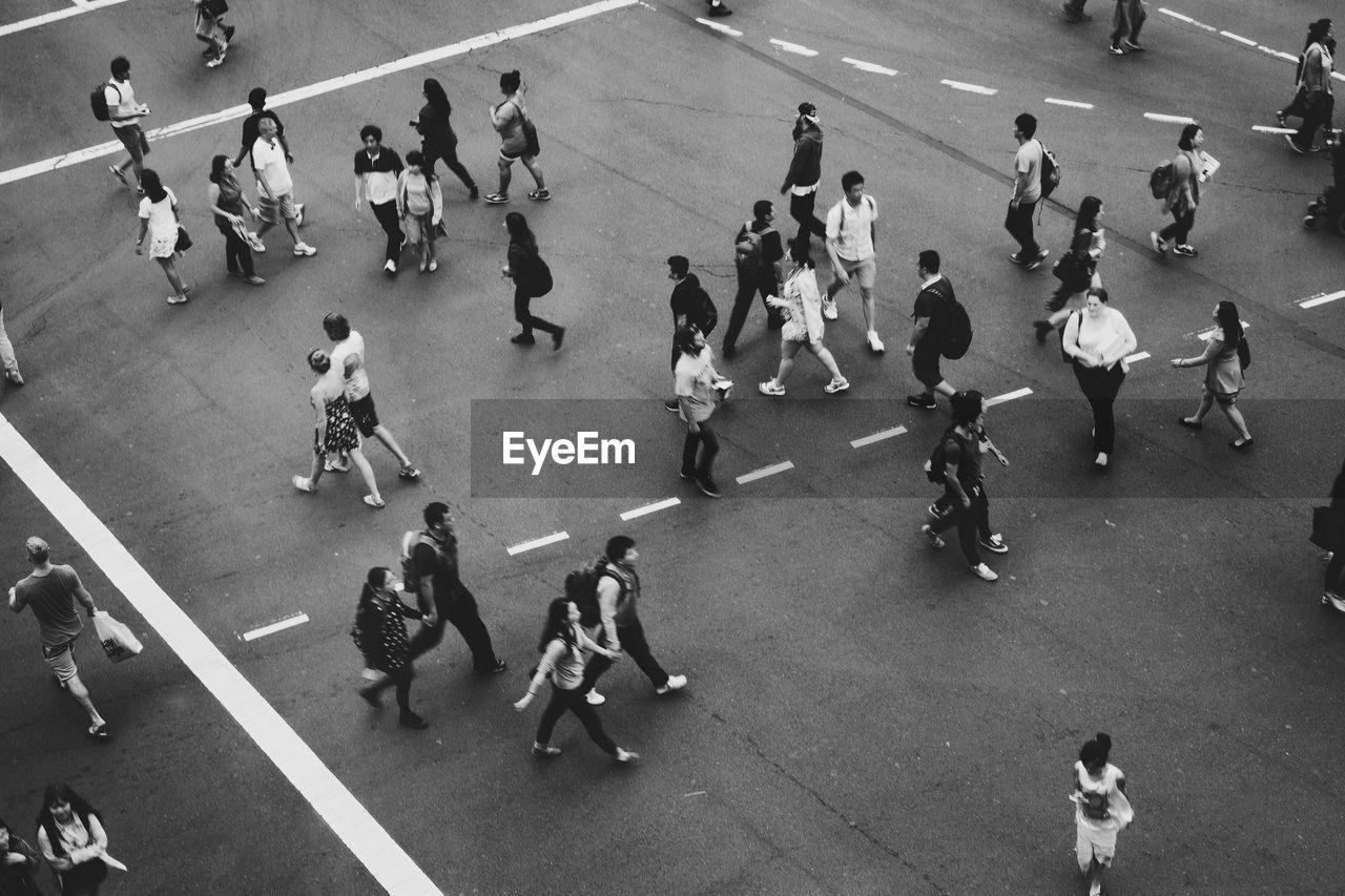 Group Of People Crossing Road