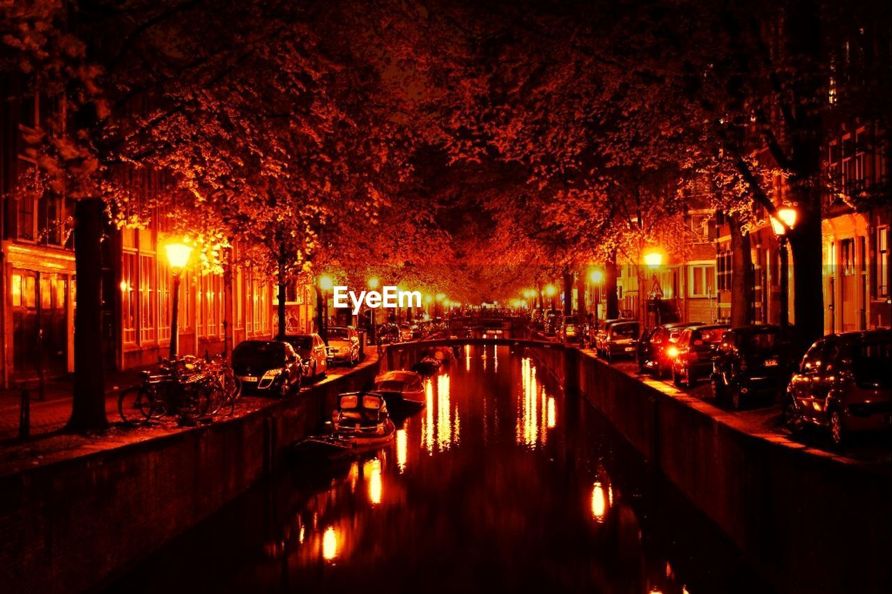 Street lights reflecting in canal