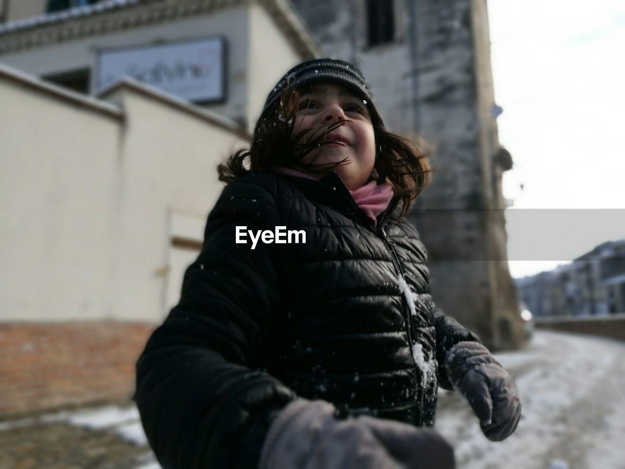 Girl Smiling In Snow