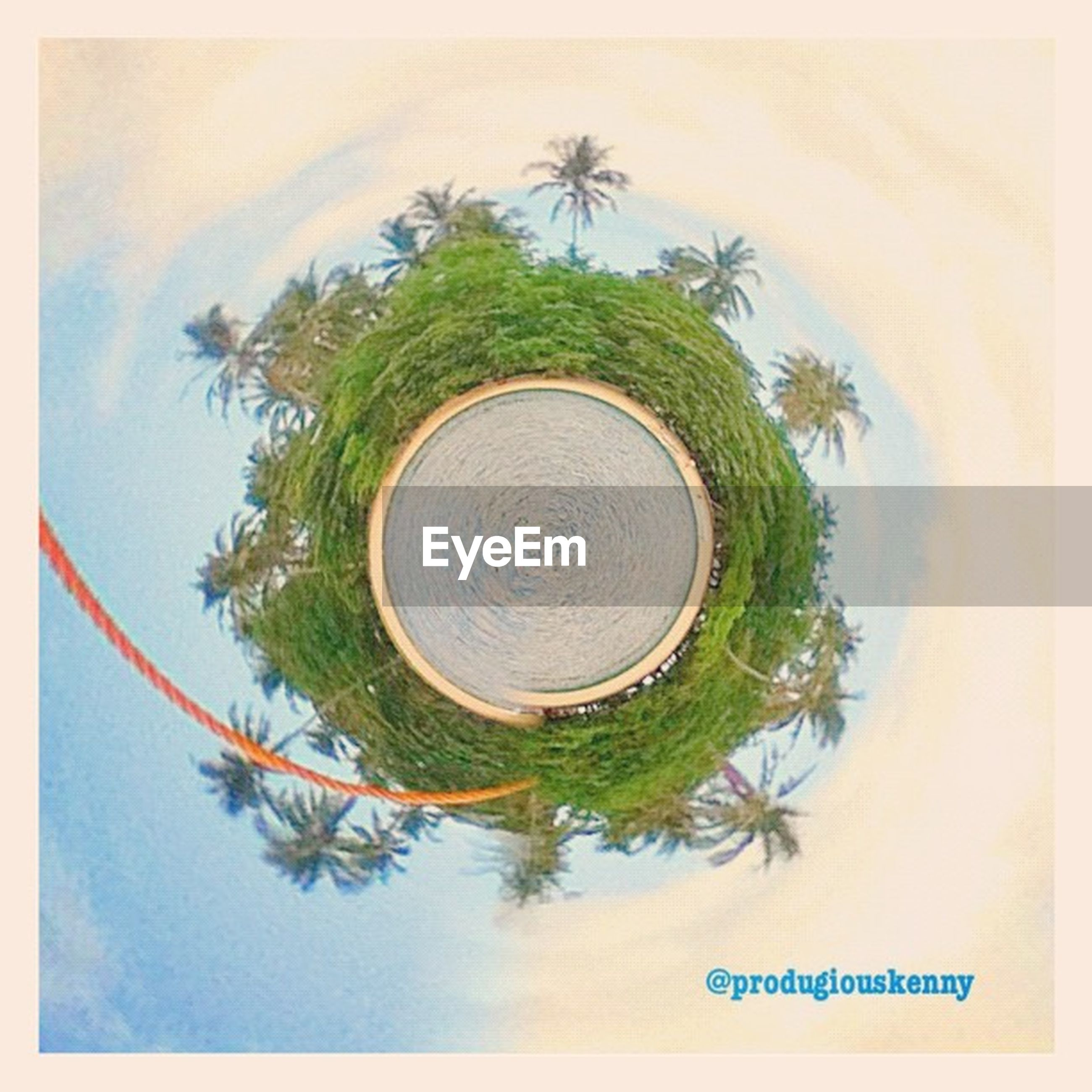tree, transfer print, palm tree, auto post production filter, sky, growth, tranquility, nature, tranquil scene, scenics, day, green color, beauty in nature, text, outdoors, water, communication, cloud - sky, sea, circle