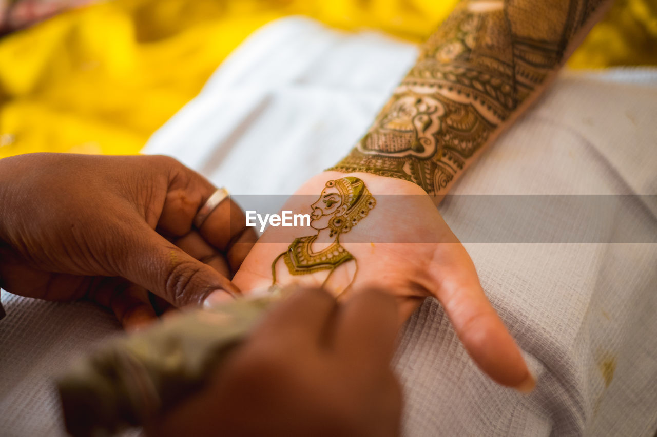 Hand of an indian bride decorated with henna or mehndi