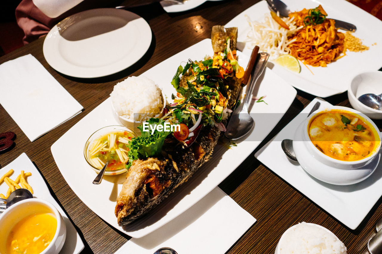 High Angle View Of Various Food Served On Table In Restaurant