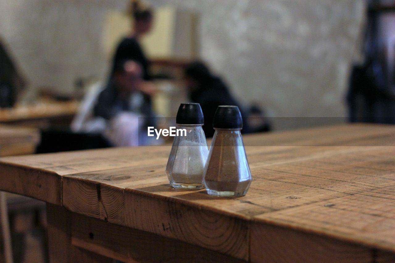 Salt and pepper shaker on table at restaurant