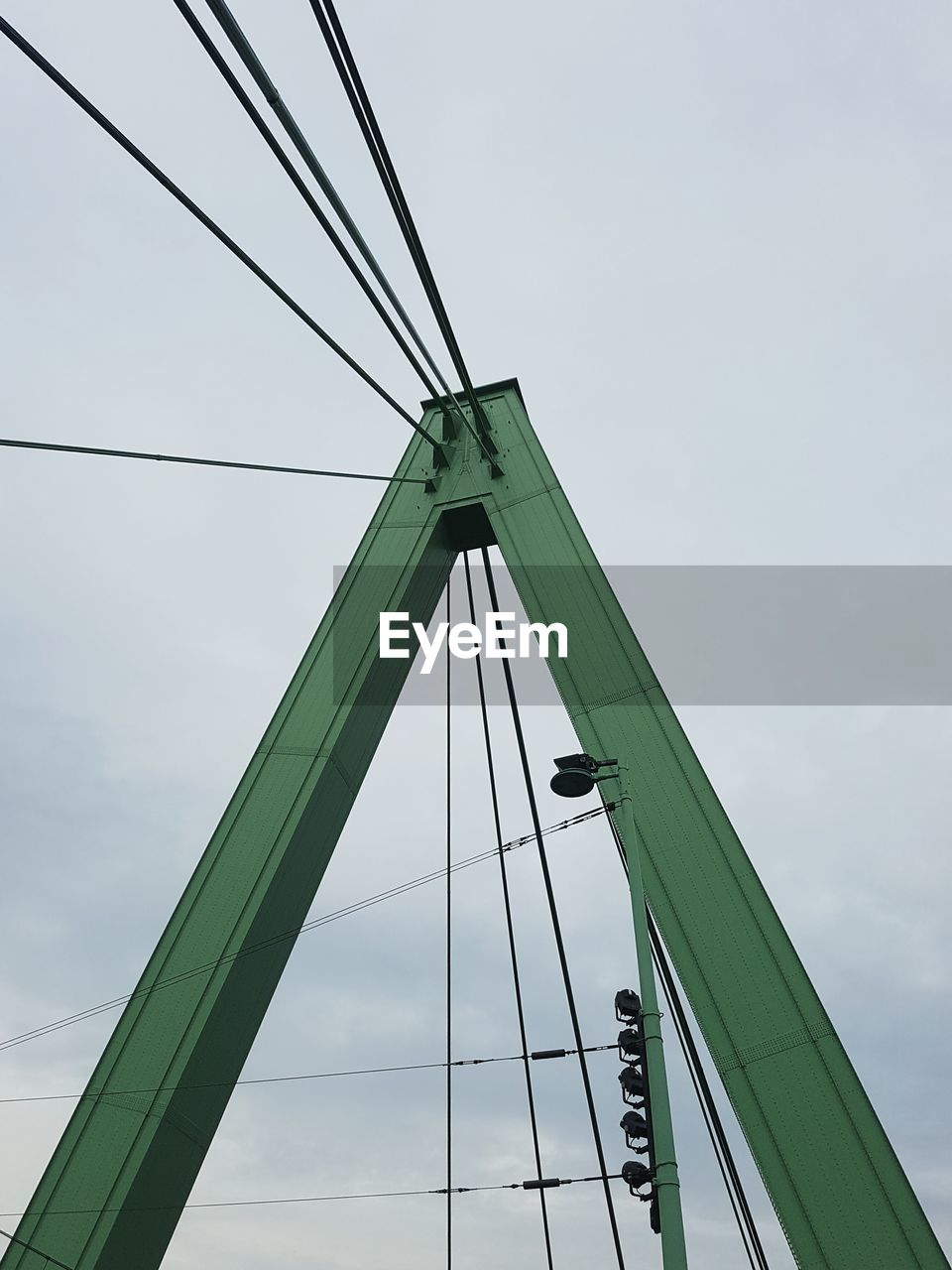 connection, low angle view, transportation, bridge - man made structure, sky, day, cable, outdoors, built structure, architecture, suspension bridge, no people