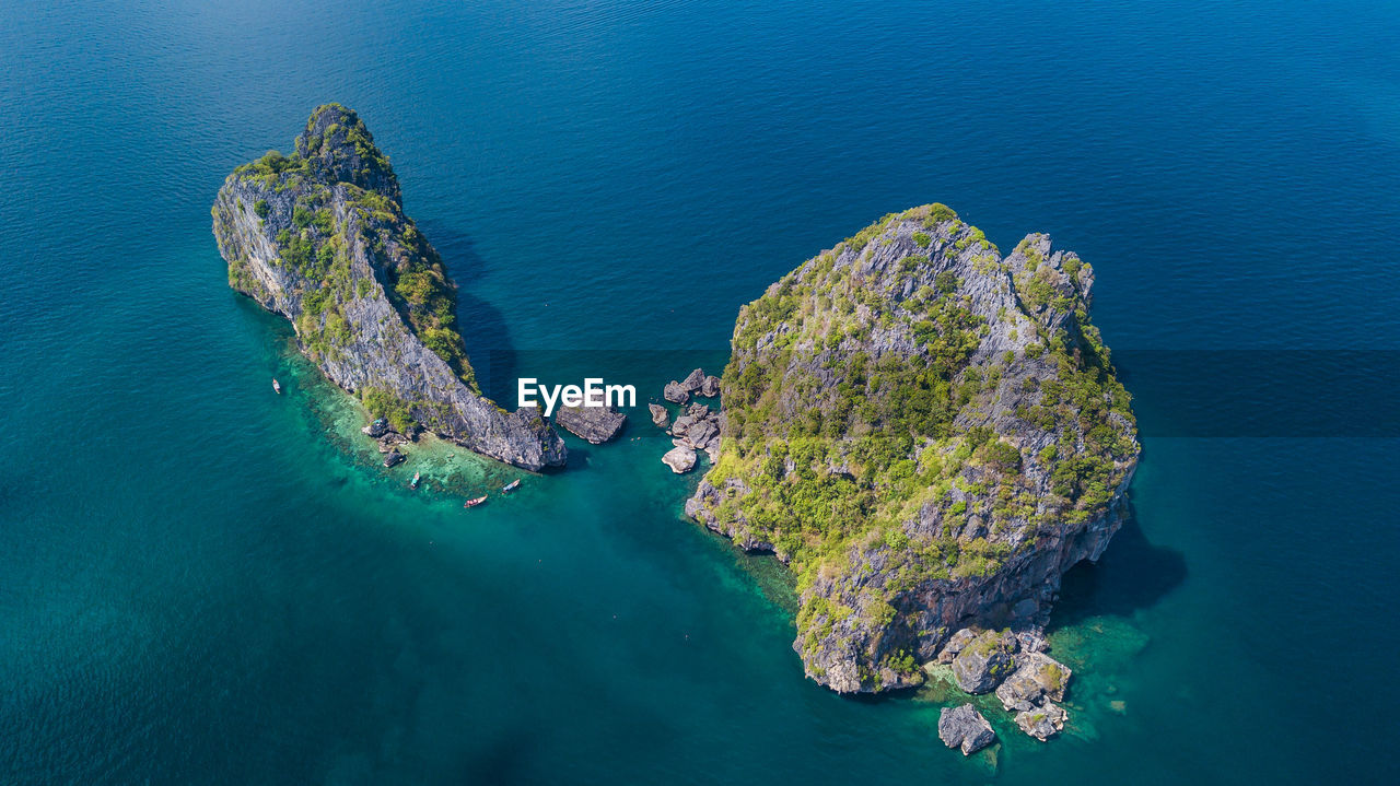 sea, water, high angle view, beauty in nature, rock - object, nature, rock, solid, scenics - nature, rock formation, no people, tranquility, land, day, outdoors, blue, aerial view, tranquil scene, waterfront, turquoise colored