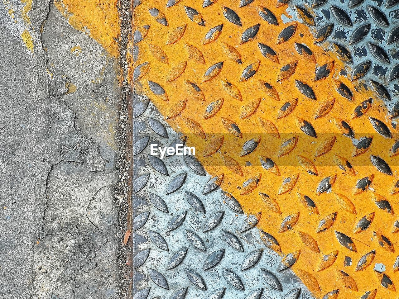 pattern, textured, full frame, no people, backgrounds, high angle view, day, yellow, close-up, wall - building feature, metal, orange color, outdoors, gray, rough, footpath, built structure, street, transportation, architecture, concrete